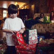 Augie begrudgingly opens his gifts