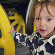 Freya checks out the 'lellow' train wheel